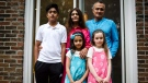 Parents Kamran, top right, and Reshma Niazi, centre, pose for a photograph with their children, front left to right, Jaffar (14), Aaliya (7) and Lilly (8) in their home in Oakville, Ont., on Monday, August 6, 2018. THE CANADIAN PRESS/Christopher Katsarov