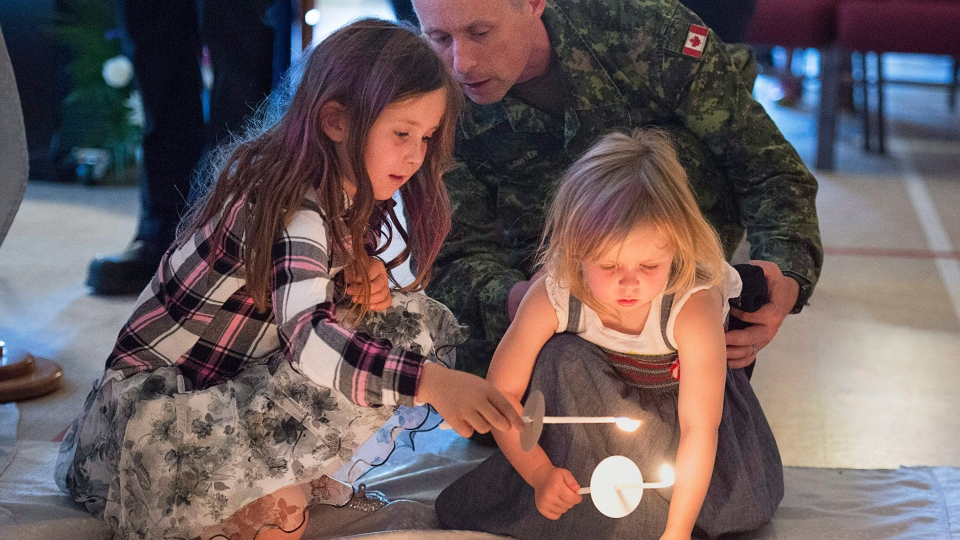 Residents attend a candlelight vigil at St. John the Evangelist Anglican Church, in Fredericton on Friday, August 10, 2018. (THE CANADIAN PRESS / Andrew Vaughan)