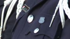 Police officeer wearing a Badge 589 pin