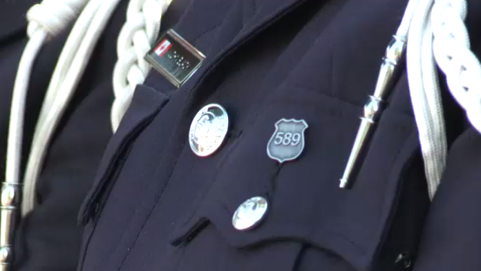 Regional police officers will wear pins in August that resemble Cst. Nicholson's badge.