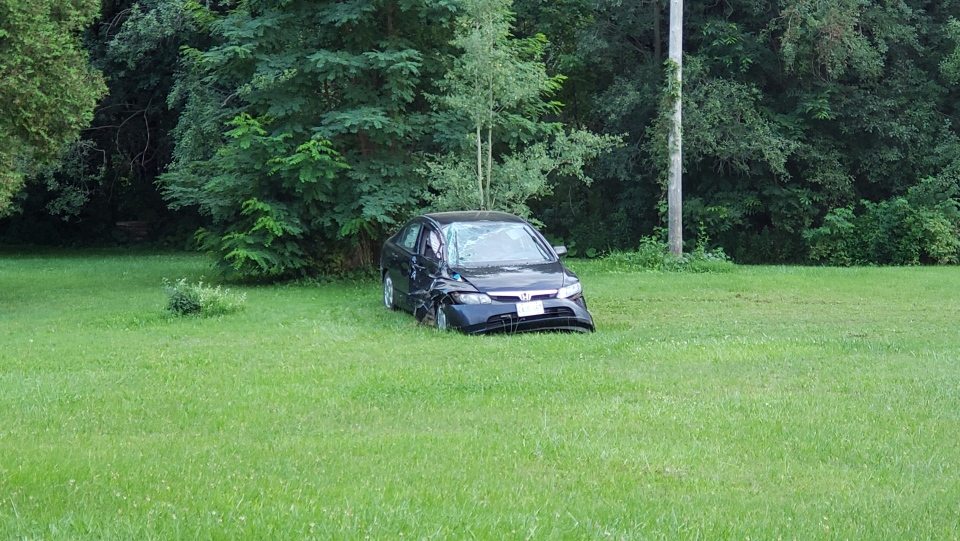 The vehicle left the roadway due to aggressive driving, police say.