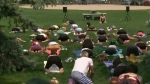 Michael Franti hosts yoga and tunes in the park