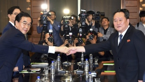 South Korean Unification Minister Cho Myoung-gyon, left, shakes hands with his North Korean counterpart Ri Son Gwon during their meeting at the northern side of Panmunjom in the Demilitarized Zone, North Korea, Aug. 13, 2018. (Korea Pool/Yonhap via AP)