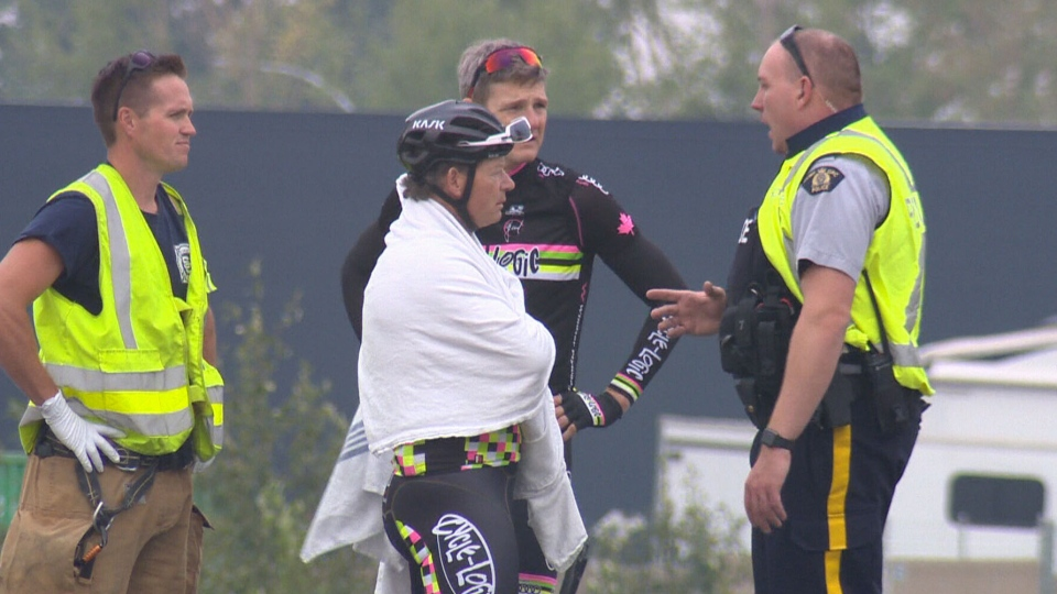 One of several cyclists hit by a pickup truck on the Sherwood Park Freeway in Edmonton speaks with a police officer.