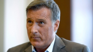 Conservative MP Maxime Bernier participates in an interview with The Canadian Press in his office on Parliament Hill in Ottawa on Wednesday, Aug. 1, 2018. THE CANADIAN PRESS/Justin Tang