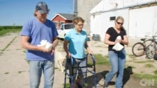 Alyssa Gilderhus and her parents, Duane and Amber Engebretson, at their farm in Minnesota. (Courtesy CNN)