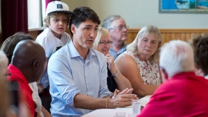 Prime Minister Justin Trudeau and his four-year-old son Hadrien meet with seniors at the Milton Community Hall in North Milton, P.E.I. on Monday, Aug. 13, 2018. (THE CANADIAN PRESS / Andrew Vaughan)