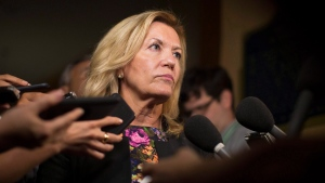 Ontario Deputy Premier Christine Elliott talks with journalists following Question Period at the Ontario Legislature in Toronto on Wednesday, August 1, 2018. (THE CANADIAN PRESS/Chris Young)