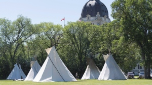Teepees are seen at the Justice for Our Stolen Children camp near the Saskatchewan Legislative Building in Regina on Wednesday June 27, 2018. THE CANADIAN PRESS/Michael Bell