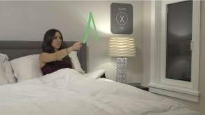 A woman draws a symbol in the air that could be used to control a light. (Motion Gestures)