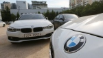 BMW cars are parked for an emergency safety check at the playground of an elementary school near a BMW service center in Seoul, South Korea, Tuesday, Aug. 14, 2018.  (AP Photo/Ahn Young-joon)