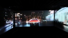 In this photo taken on Thursday, Aug. 9, 2018, a trailer shows a car speeding through traffic as part of a demonstration for ScreenX at Cineworld in London. (AP Photo/Robert Stevens)