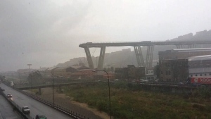 Bridge collapses in Italy during heavy storm, crushing cars | CTV News
