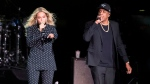In this Nov. 4, 2016 file photo, Beyonce and Jay-Z perform during a Democratic presidential candidate Hillary Clinton campaign rally in Cleveland. ( AP Photo/Matt Rourke, File)