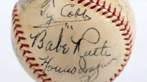 In this undated photo provided by SCP Auctions is a baseball with the signatures of Babe Ruth, Ty Cobb, Honus Wagner and eight other legends of the game that has sold for more than $600,000. The players all signed the ball on the same day in 1939, when they had gathered to become the first class to enter the Baseball Hall of Fame. (SCP Auctions via The Associated Press)
