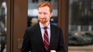 Benjamin Grant, a lawyer for Vice Admiral Mark Norman, leaves the courthouse following a hearing in Norman's breach of trust case, in Ottawa on Tuesday, Aug. 14, 2018. THE CANADIAN PRESS/Justin Tang