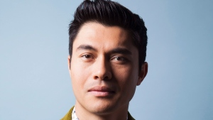 "In this Aug 4, 2018 photo, actor Henry Golding poses for a portrait at the Beverly Wilshire Hotel in Beverly Hills, Calif. to promote his film ""Crazy Rich Asians."" (Photo by Rebecca Cabage/Invision/AP)"
