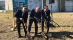 Ralph Goodale, Warren Kaeding and Michael Fougere break ground on a new transit maintenance facility on Aug. 14, 2018 (Colton Wiens / CTV Regina)