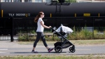 New UK research has found that babies in strollers could be exposed to up to 60 per cent more pollution than their caregivers. (AP Photo/Matt Rourke)
