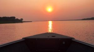 Smokey skies make way for a beautiful evening cruise along the Winnipeg River. Photo by Shawna Peterson.