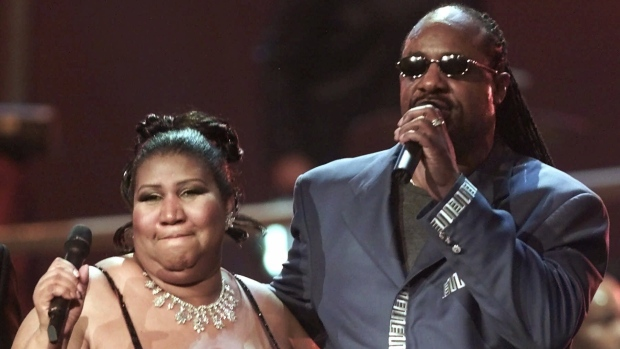 """In this 2001 file photo, Aretha Franklin sings with Stevie Wonder at the finale of the """"VH1 Divas 2001: The One and Only Aretha Franklin"""" event Tuesday, April 10 in New York. (AP Photo/Suzanne Plunkett)"""