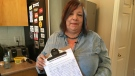 Susan Sedgemore of Caledon, Ont. holds the petition with signatures on Tuesday, August 18, 2018. (CTV News/KC Colby)