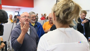 Shouting broke out between supporters and detractors of the project at a community meeting in Winnipeg on Tuesday.