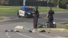 Police attend to a collision between a vehicle and a motorcycle in Oakville on Aug. 14, 2018. (David Ritchie)