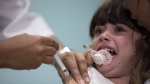 Lara Melo, 3-year-old, receives a vaccine against measles in Rio de Janeiro, Brazil, Monday, Aug. 6, 2018. (AP Photo/Leo Correa)