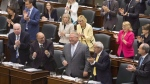 Ontario Premier Doug Ford is applauded by his PC Party members during Question Period at the Ontario Legislature in Toronto on July 30, 2018. (THE CANADIAN PRESS/Chris Young)