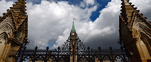 The Peace Tower is seen through the front gates of Parliament Hill in Ottawa in Ottawa on Tuesday, May 2, 2017. (THE CANADIAN PRESS / Sean Kilpatrick)