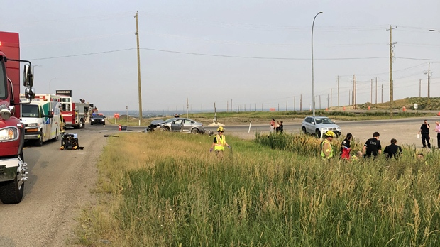 Emergency crews attend to an injured motorcyclist near the intersection of Highway 22X and 37 St SW
