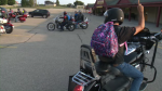 Dozens of motorcyclists delivery backpacks stuffed with goodies to kids in need.