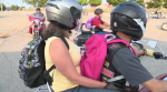 Motorcyclists delivery backpacks to Send Em Off Smiling warehouse.