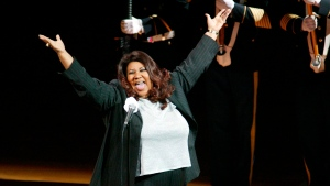 In this June 15, 2004 file photo, singer Aretha Franklin sings the National Anthem before the start of game 5 of the NBA Finals between the Detroit Pistons and the Los Angeles Lakers in Auburn Hills, Mich. (AP Photo/Al Goldis, File)