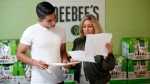 DeeBee Organics owner Dionne Laslo-Baker is photographed with finance analyst Sanjeev Kang during a meeting at her office in Victoria on Monday, August 13, 2018. (THE CANADIAN PRESS/Chad Hipolito)