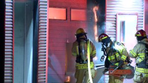 firefighters cut through door