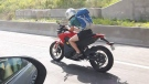 This photo of a motorcycle rider holding a cell phone was taken on Aug. 13, 2018 on Highway 15 near Ste. Adele, Quebec, and posted to Facebook.