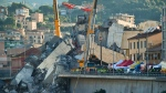 Rescuers search the crumbled hulk of the collapsed Morandi highway bridge in Genoa, northern Italy, Wednesday, Aug. 15, 2018.  (Luca Zennaro/ANSA via AP)
