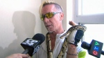 'Snake Man' George Warner speaks to reporters after rescuing a suspected python from a Toronto apartment, Wednesday, Aug. 15, 2018.