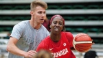 Tamara Tatham drives through a defender during the Canadian women's national basketball team's practice in Edmonton, Alta., on Thursday, July 8, 2016. (THE CANADIAN PRESS / Dan Riedlhuber)