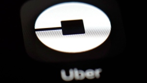This March 20, 2018, file photo shows the Uber app on an iPad in Baltimore. Uber reports earnings Wednesday, Aug. 15. (AP Photo/Patrick Semansky, File)