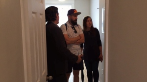 Potential tenants check out apartment with broker.