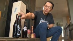 Don Tse shows off some of the beers in his collection ahead of his 20,000th beer that he will consume at Saturday's fundraiser at the Pig and Duke