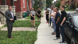 People line up to view a bachelor apartment in Ottawa, on Wednesday, Aug. 15, 2018.