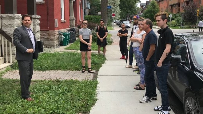 People line up to view a bachelor apartment