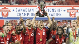 Toronto FC captain Michael Bradley lifts the Voyageurs Cup after beating Vancouver Whitecaps 5-2 to win the Canadian Championship Final, in Toronto on Wed., Aug. 15, 2018. THE CANADIAN PRESS/Chris Young
