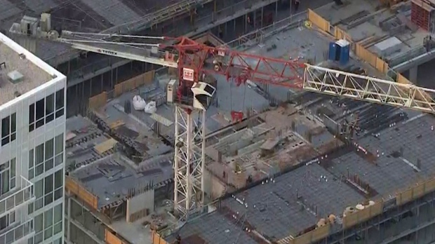 Firefighters were called to rescue a woman from a construction crane near Lakeshore Boulevard and Dan Leckie Way in Toronto.