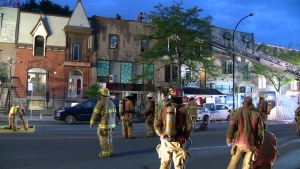 Montreal firefighters deal with a fire in a commercial-residential building on St. Denis St. on Aug. 15, 2018 (CTV Montreal/Cosmo Santamaria)