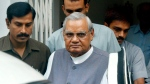 In this Aug. 23, 2004 file photo, senior Bharatiya Janta Party (BJP) leader Atal Bihari Vajpayee, centre, leaves after a meeting at the party headquarters in New Delhi, India. (AP Photo/Sebastian John, File)